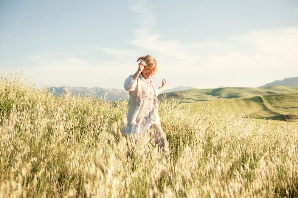 woman smiling in field