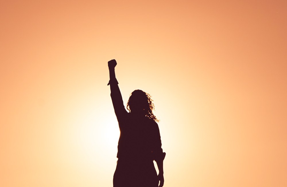 woman with hand in the air