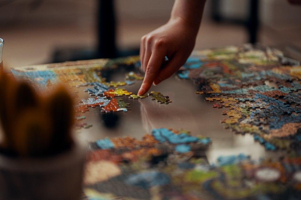 person placing puzzle piece