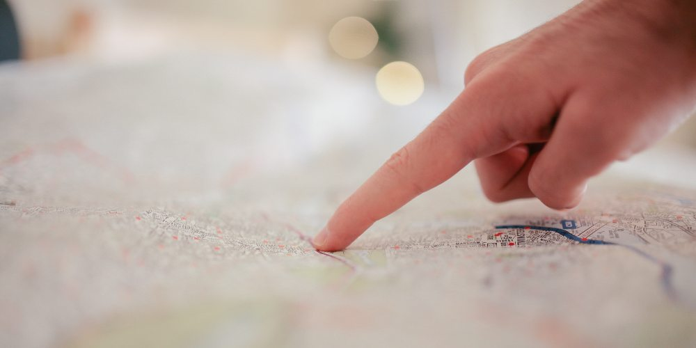 someone pointing to a map